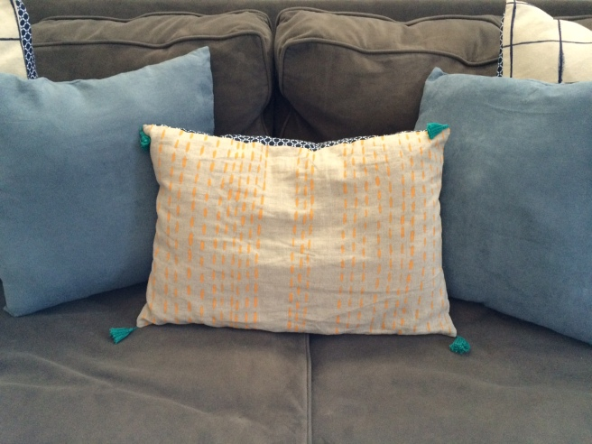 Hand-painted tangerine pillow on linen with aqua tassels